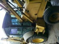 1999 New Holland 555E backhoe with cab. Air, heat, 3