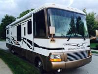 THIS 35 FT CLASS A MOTORHOME HAS 79,444 BABIED MILES ON