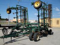 30' field cultivator with drag sweeps and with