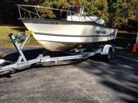 enter Console w/ stainless bow rails, GPS depth-finder,