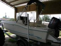 For sale is a 99 Scout 185 Sport Fish center console in