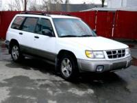 1999 Subaru Forester L it is white with gray cloth