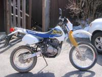 1999 suzuki dr 350e with 1900 original miles. The bike