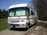 This vehicle is a 1999 Class-A Winnebago Brave Model