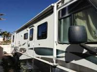1999 Winnebago Itasca Sunrise. With its predominantly