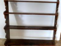 19th century handmade walnut graduated wall shelf. Old