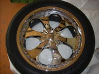 Set of 4 rims, 4 tires, and spinning wheel attachment.