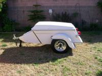 Includes Ice Chest and cargo bay, Chrome wheels, all