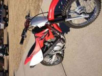 For sale is a 2006 Honda CRF80 dirt bike. This dirt