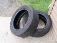 2- Michelin Defender 205/55/r16 tires, about 1/2