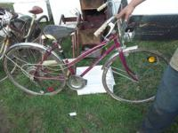 2 vintage Iverson touring bikes one guys, cream colored