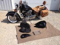Classic black with initial Indian tan leathers,