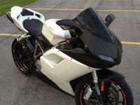 .,.,2009 Ducati 848 in pearl white. This bike has never