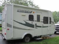 This unit includes a free standing table, awning,