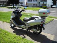 Like new, Silver 250cc scooter, water cooled, only