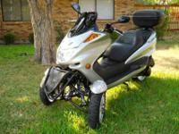 Eye catching silver 150cc trike for a little fun in the