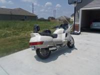 This is a 1989 Honda PC 800, sport touring motorcycle.