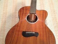 The Tacoma EKK-19C is an acoustic electric guitar made