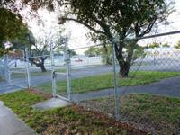 91,344 Sq Ft corner land lot which is a paved asphalt