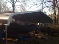 2 1/2 car steel awning brown in color, 18 1/2 ft wide 8