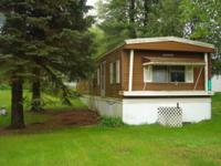 This 2/1 mobile home has easy access to US-10 and