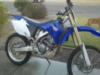 Selling an seven yz250f dirt bike. New plastics, rear