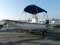 2001 Carolina Skiff J-16 center console with her 2007