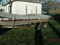 16 ft bass tracker with trailer. 25h.p. merc motor and
