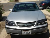 -2002 Chevy Impala; V6, 3.4L, silver color with grey