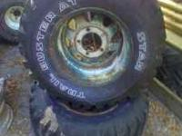 2 31x12.50R15 mud tires on ford 5x5.5 rims. $30 Call or