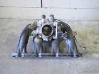 This is a plastic intake manifold and throttle body for