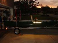 12' Jon boat with 2 seats, 4 stroke Mercury Engine that