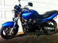 For sale is a used, blue, Kawasaki ZR-7 with 9,994