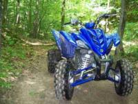 This is a 2007 Yamaha Raptor 350 & Utility Trailer. ATV