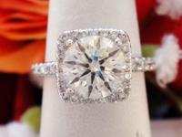 This is a 2.59CT Round Brilliant Diamond Halo