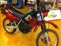 Kawasaki KLR250 with only 766 mis. This bike is clean
