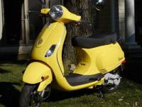 You are looking at a Vespa LX 50 that my mom bought for