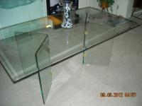 I have an Elegant, All Glass Beveled Dining Table w/ 4