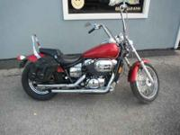 This is a 2003 Honda Shadow 750cc with some extras. 17k