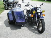 The bike and the sidecar was owned and the Mona Lisa