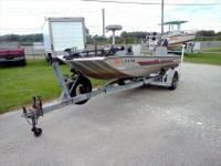 990 Tracker Tournament TX 17, powered by a 50hp