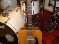 I have an Alvarez Acoustic Guitar, its in good shape.
