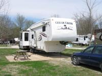 .,.2004 Cedar Creek fifth wheel. The trailer is 39 feet