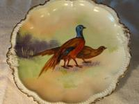 These are lovely old hand painted Limoges game bird