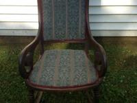 Stylish Antique rocker with solid wood frame and fabric
