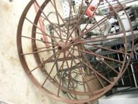 "I have 2 Antique 42"" Metal Wagon Wheels for sale. I"