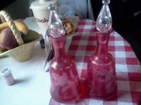 My grandma has a Set of 2 Antique Wine Decanters for