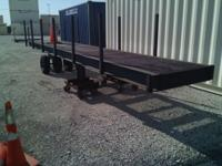 LIKE NEW! This 2 Axel 4' X 24' Beam Trailer is in Great