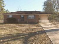 COZY BRICK HOME IN COUNTRY WITH APPROXIMATELY 1/2 ACRE,