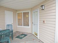 Immaculate ground floor corner unit at rear of property